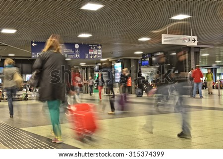 BRUSSELS, BELGIUM-SEPTEMBER 26, 2014: Interior with motion blur of Brussels-South Railway Station or Gare du Midi. This is the biggest railway station of the city which was opened in 1952 - stock photo