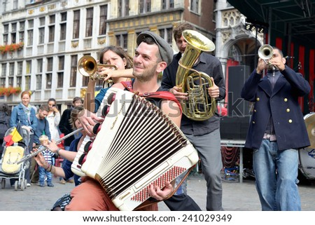 BRUSSELS, BELGIUM-SEPTEMBER 21, 2013: Unidentified urban actors participate in activities on Grand Place after ceremony of award of costume to Manneken Pis - stock photo