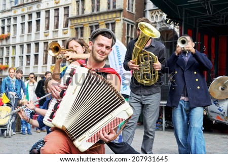 BRUSSELS, BELGIUM-SEPTEMBER 21, 2013: Unidentified urban performers participate in activities on Grand Place after ceremony of award of costume to Manneken Pis - stock photo