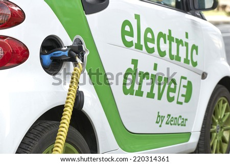 BRUSSELS, BELGIUM - SEPTEMBER 28, 2014: Zen Car Europe's first electric car to rent on Bld Botanique in front of the Financial tower on September 28, 2014 in Brussels, Belgium - stock photo