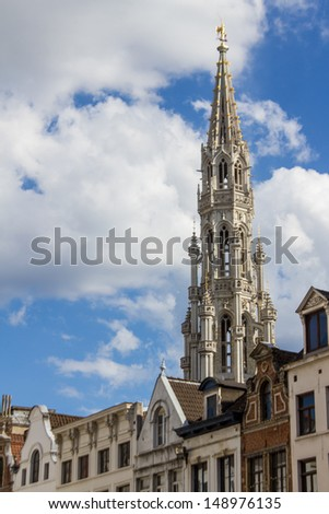 brussels city hall tower seen from a street beside