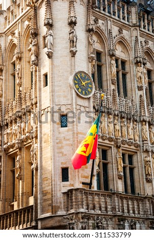 Brussels city hall with flag and clock - stock photo