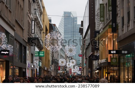 BRUSSELS - DECEMBER 18: People on the second most popular shopping area in Belgium:  Rue Neuve on December 18, 2014 in Brussels.  - stock photo