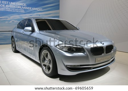 BRUSSELS - JANUARY 23: BMW 5 Hybrid Concept car on display at Euro motors 2011 exhibition on January 23, 2011 in Brussels, Belgium. - stock photo