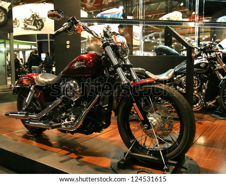 BRUSSELS - JANUARY 13: Harley-Davidson Street Bob bike on display at Euro motors 2013 exhibition on January 13, 2013 in Brussels, Belgium. - stock photo