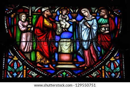 BRUSSELS - JULY 26: Holy Family on a stained glass in the cathedral of Brussels, Belgium, on July 26, 2012.