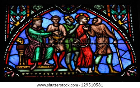 BRUSSELS - JULY 26: Jesus on Good Friday before Pontius Pilate, on a stained glass window in the cathedral of Brussels, Belgium, on July 26, 2012. - stock photo