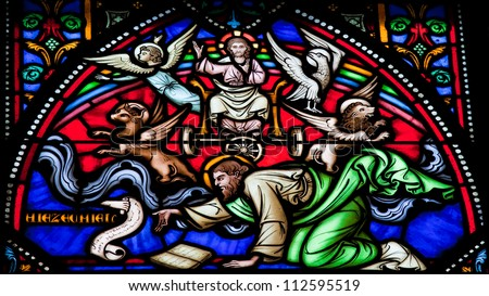 BRUSSELS - JULY 26: Stained glass window depicting Cherubim and Chariot vision of the Prophet Ezekiel in the cathedral of Brussels on July, 26, 2012. - stock photo