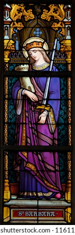 BRUSSELS - JULY 26: Stained glass window depicting Saint Barbara, in the cathedral of Brussels on July, 26, 2012. - stock photo