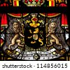 BRUSSELS - JULY 26: Stained glass window depicting the coat of arms of Belgium with the national motto 'L'Union fait la force (Union makes power) in the cathedral of Brussels on July, 26, 2012. - stock photo