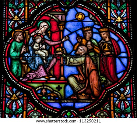 BRUSSELS - JULY 26: Stained glass window depicting the three kings from the East visit the Holy Family in Bethlehem, in the cathedral of Brussels on July, 26, 2012. - stock photo