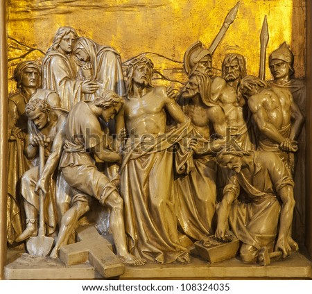 BRUSSELS - JUNE 24: Jesus is stripped of his garments. Relief from Saint Antoine church on June 24, 2012 in Brussels.