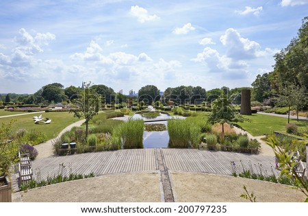 "BRUSSELS-JUNE 24, 2014. Public garden called ""les jardins du fleuriste"" or Stuyvenberg near Laeken park in Brussels, Belgium on June 24, 2014 - stock photo"