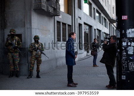 BRUSSELS - MARCH 23: Belgium Army secure the Central Station - Main Railway station of Brussels on March 23, 2016 in Brussels, Belgium, one day after the 2 terrorist attacks that hit the city. - stock photo