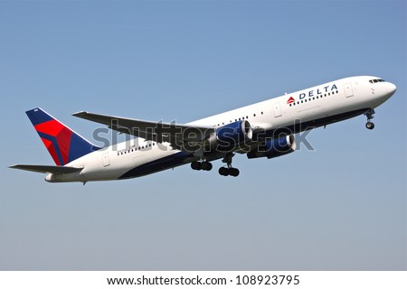 BRUSSELS - MAY 25: A Boeing 767-300 approaching Brussels Airport in Brussels, BELGIUM on May 25, 2012. Delta is one of the major American Airlines is rated top 10 the biggest in the world. - stock photo