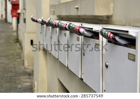 BRUSSELS - MAY 01: A newspapers was placed in a mailbox. Delivery of daily newspaper in Brussels on May 01. 2015 in Belgium - stock photo