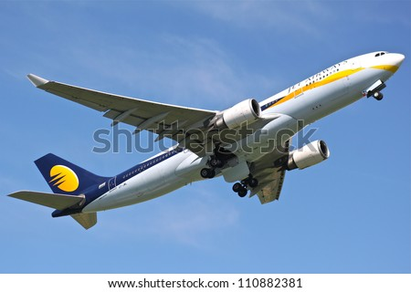 BRUSSELS - MAY 25: An Airbus A330-200 approaching Brussels Airport in Brussels, Belgium on May 25, 2012. Jet Airways is the second largest Indian airline based in Mumbai. - stock photo