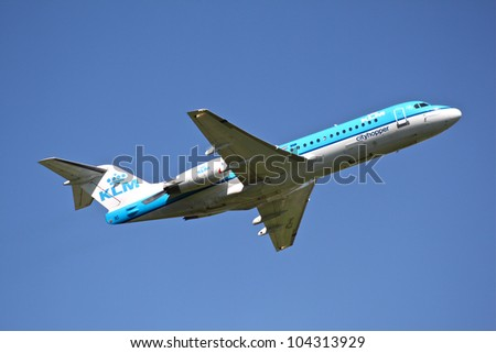 BRUSSELS - MAY 25: Fokker 70 of KLM taking off from Brussels Airport in Brussels, BELGIUM on May 25, 2012. KLM is the flag carrier airline of the Netherlands. - stock photo