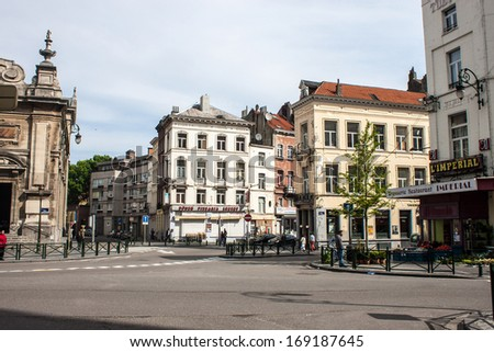 BRUSSELS - MAY 19: View of a street on May 19, 2013 in Brussels, Belgium. Brussels is the capital of Belgium and the de facto capital of the European Union.