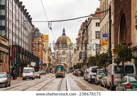 BRUSSELS - OCTOBER 7, 2014: Royal street in Brussels with Saint Mary's Royal Church on October 7, 2014 in Brussels, Belgium. It is a Roman Catholic parish church located on the Place de la Reine. - stock photo