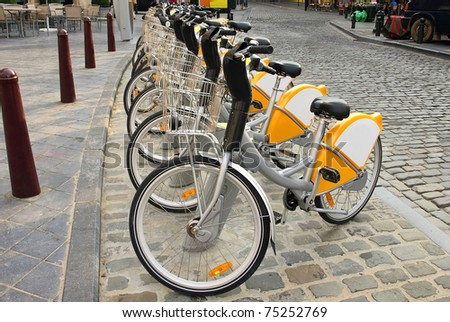 Brussels, parking for rental bicycles in the street. - stock photo