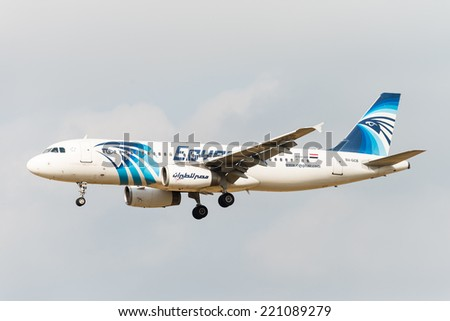 BRUSSELS - SEPTEMBER 30: Airbus A320-232 of Egyptair approaching Brussels Airport in Brussels, BELGIUM on SEPTEMBER 30, 2014. Egyptair is the flag carrier airline of Egypt. - stock photo