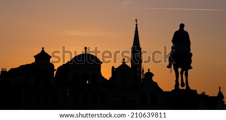 Brussels - Silhouette of king Albert statue and tower of town hall from Monts des Arts in evening