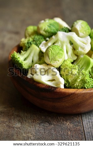 Brussels sprout,broccoli and cauliflower in wooden bowl. - stock photo