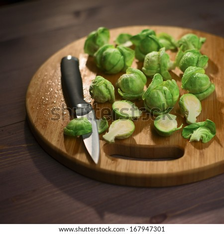 Brussels Sprout on wood cutting board - stock photo