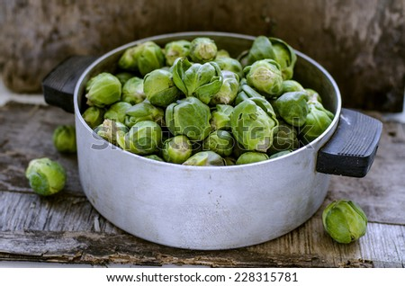 Brussels sprouts cabbage on old wooden table - stock photo