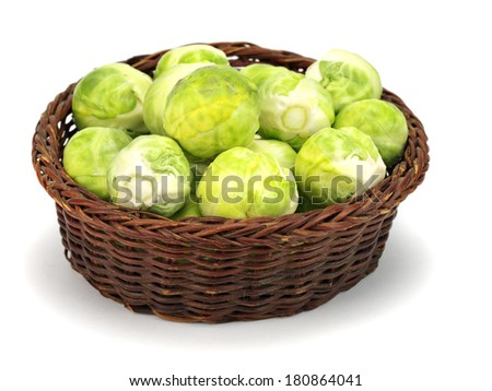 Brussels sprouts in basket on white background