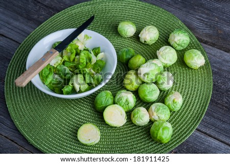brussels sprouts on wood table - stock photo