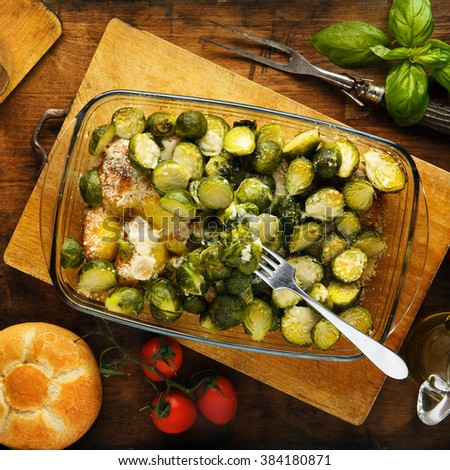brussels sprouts roasted with potatoes and cheese - stock photo