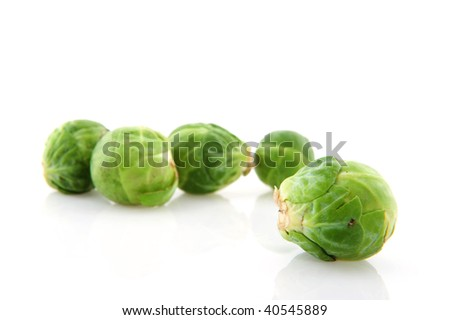 Brussels sprouts vegetables in studio with white background - stock photo