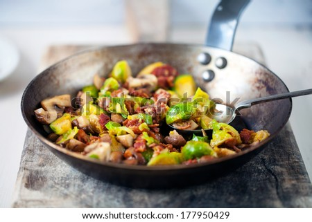 Brussels sprouts with mushrooms and bacon - stock photo
