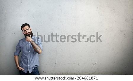 Brutal bearded man thinking - stock photo