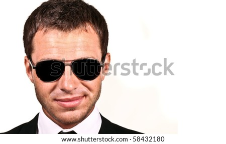 Brutal man in sunglasses - stock photo