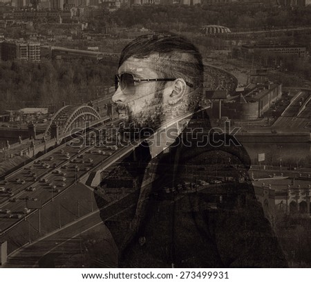 Brutal man with a beard and sunglasses on city background. Photo collage, effect of multiple exposure