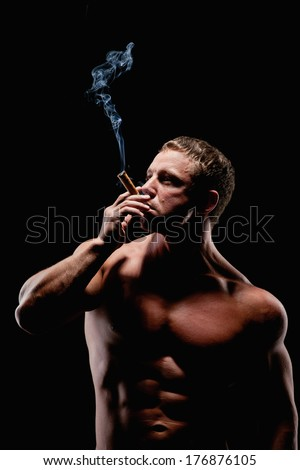 Brutal man with a cigar - stock photo