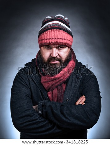 Brutal portrait of a mature frowning gloomy man - stock photo