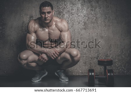Brutal strong athletic men pumping up muscles workout bodybuilding concept grey background - muscular bodybuilder handsome men doing exercises in gym naked torso fitness and bodybuilding