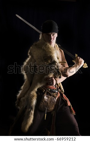 Brutal Warrior in wolf skin - stock photo