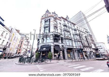 BRUXELLES - MAY 1, 2015: Tourists and locals along city streets. Brussels attracts 10 million tourists every year. - stock photo