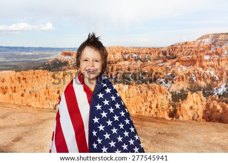 Bryce Canyon National Park and boy with USA flag - stock photo