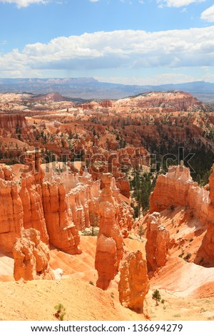Bryce Canyon National Park landscape, Utah, USA. Nature scene showing beautiful hoodoos, pinnacles and spires rock formations. including Thors Hammer. Image is from summer.