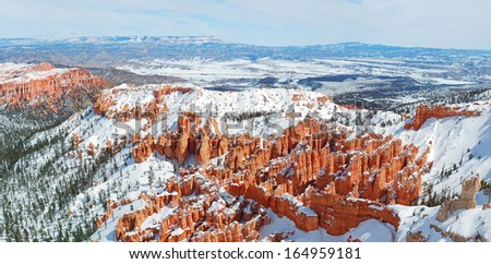 Bryce canyon panorama with snow in Winter with red rocks and blue sky.  - stock photo