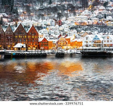 Bryggen street with wooden houses  with reflection in Bergen at Christmas, Norway - stock photo