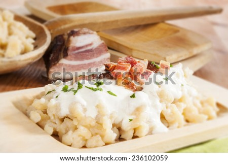 Bryndzove halusky. Potato dumplings with bryndza sheep cheese and bacon. Bryndzove halusky, traditional national slovak food. - stock photo