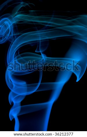 bstract blue smoke over black background
