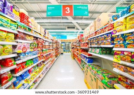 Buayai Nakhonratchasima, 3 JANUARY 2016: Rows of shelves in Tesco Lotus supermarket in Buayai district, Nakhonratchasima province, Thailand. Tesco Lotus is a largest hypermarket chain in Thailand - stock photo